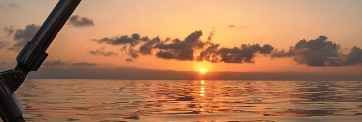 Sailing sunset on the water illustrates living one day at a time