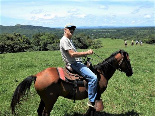 Horseback Riding, Green Hills, Blue Skies